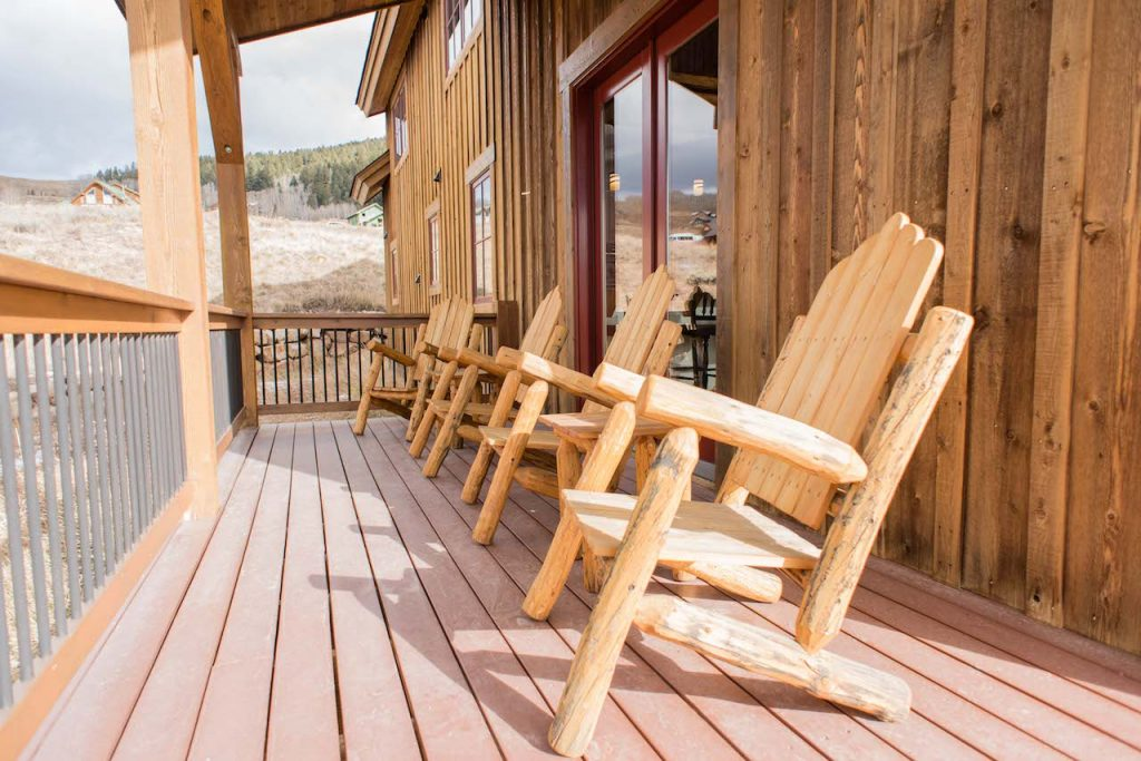 Crested Butte Vacation Rental wrap around porch with Adirondack chairs