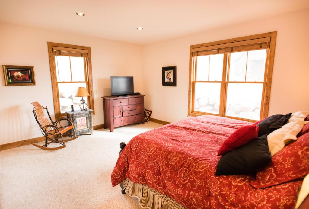 Crested Butte Vacation Rental Master bedroom with king bed and TV