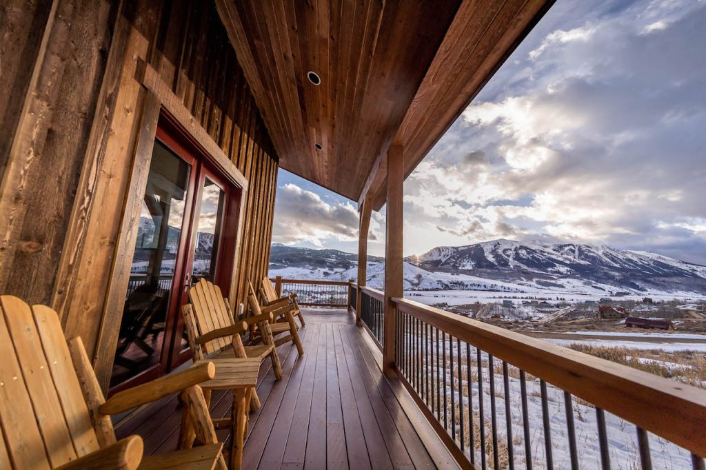 Crested Butte Vacation Rental wrap around front porch with view of mountains
