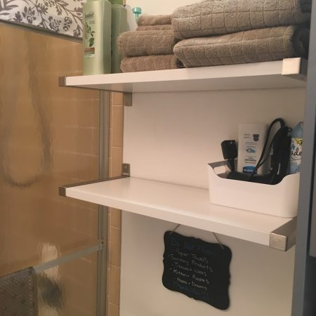 Quaint Winter Park Vacation Rental bathroom shelves stocked with all you need
